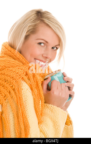 Portrait of young autumnal woman holding mug isolated on white background - Stock Photo