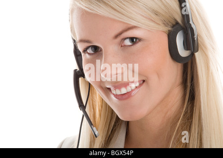 Portrait of attractive secretary/telephone operator wearing headset isolated on white background - Stock Photo