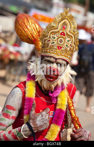 Young man dressed as Hanuman during the Camel Fair in Pushkar India - Stock Photo