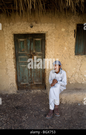 Young man sitting in Siwa - Stock Photo