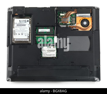 Laptop computer bottom side with back panels removed showing HDD, memory, processor and WiFi module isolated on - Stock Photo
