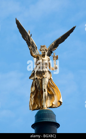 Gold Angel of Peace - Stock Photo