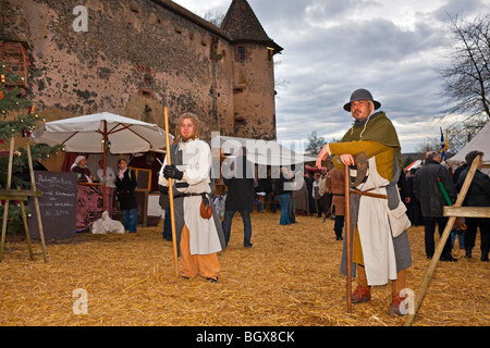 Men dressed in medieval clothing during the medieval markets on the grounds of Burg Ronneburg (Burgmuseum), Ronneburg - Stock Photo