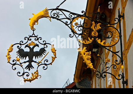 Intricate wrought iron bracket on the side of a building in Hessenpark (Open Air Museum), Neu-Anspach, Hessen, Germany, - Stock Photo