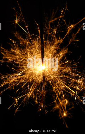 Closeup of a sparkler on a black background - Stock Photo