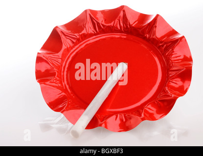 Red Foil Ashtray with Cigarette - Stock Photo