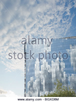 Clouds reflected in building - Stock Photo