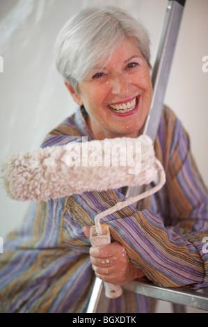 Mature woman doing DIY - Stock Photo