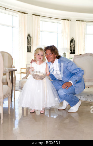 father groom with daughter flower girl - Stock Photo
