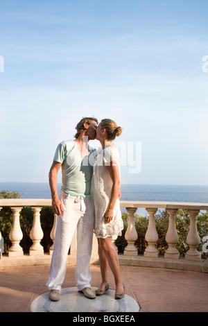 loving couple kiss at balcony - Stock Photo