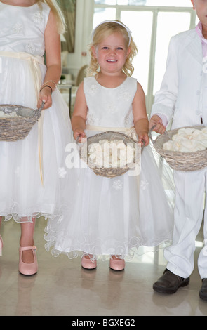girl bridesmaid with rose petals - Stock Photo
