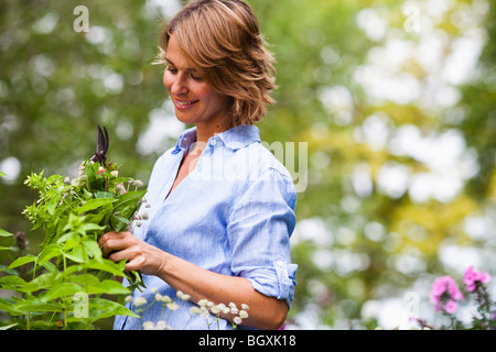 woman taking care of plants - Stock Photo