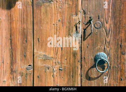 Old wooden doors with antique door furniture - Stock Photo