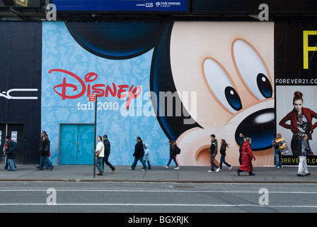 Signage announces the arrival of a new Disney store in Times Square in New York - Stock Photo