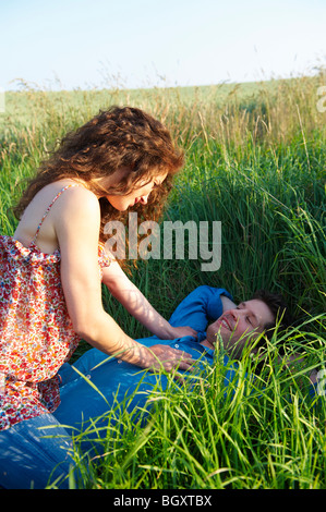 Couple in a wheat field - Stock Photo