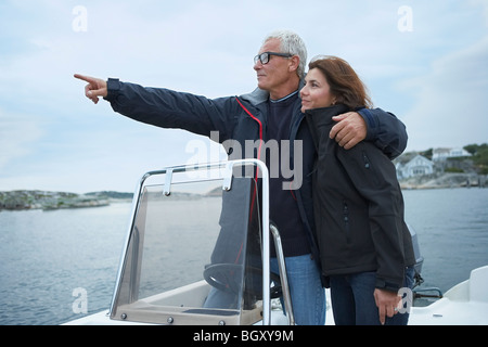 Middle aged couple on motor boat - Stock Photo