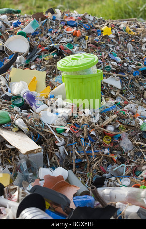 Full garbage can in midst of landfill - Stock Photo