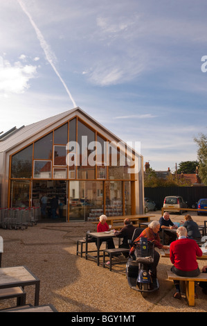 People enjoying refreshments outdoors at the Adnams cafe in Southwold , Suffolk , England , Britain , Uk - Stock Photo