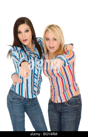 Female Caucasian friends acting silly on white background - Stock Photo