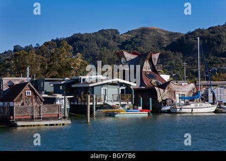 Sailboats are docked next to HOUSE BOATS IN SAUSALITO - SAN FRANCISCO BAY, CALIFORNIA - Stock Photo