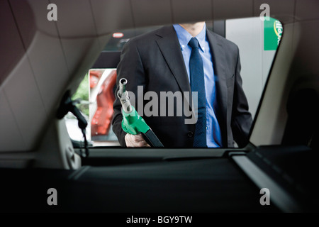 Preparing to refuel car at gas station - Stock Photo