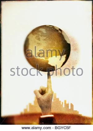 Businessman spinning globe - Stock Photo