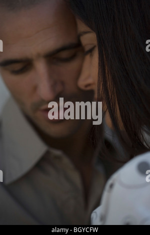 Couple touching foreheads, close-up - Stock Photo