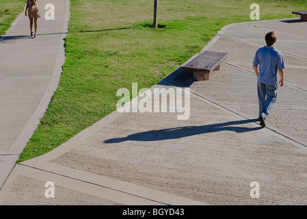 Pedestrians walking in park, high angle view - Stock Photo