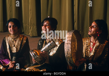 Women musicians perform and play folk music at a performance in Kuwait City. - Stock Photo