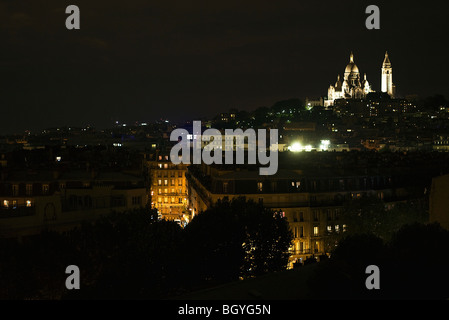 France, Paris at night, Sacre Coeur illuminated in background - Stock Photo