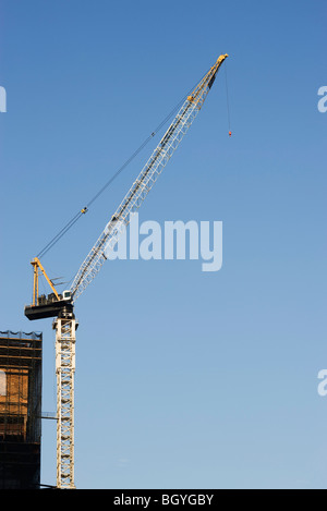 Crane and building under construction - Stock Photo