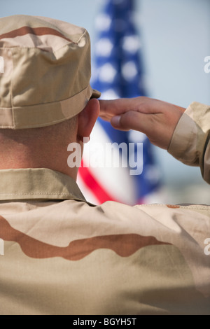 Soldier saluting - Stock Photo