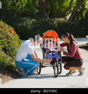 Parents and stroller - Stock Photo