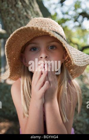 Girl wearing straw hat - Stock Photo