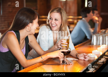 Friends drinking at bar - Stock Photo