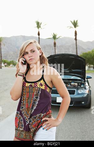 Woman talking on cellular phone - Stock Photo