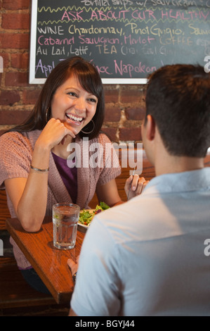 Couple eating at restaurant - Stock Photo