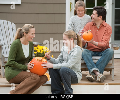 Family sitting on deck