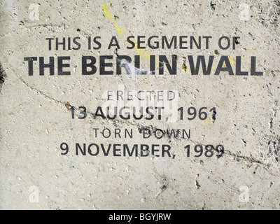 caption on a large section of the Berlin Wall erected as a display - Stock Photo