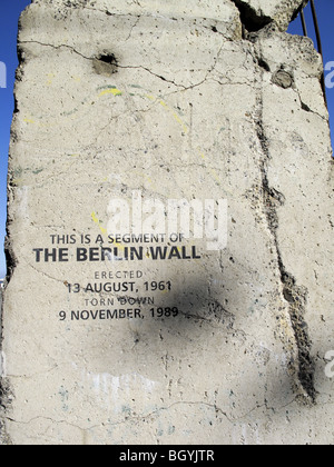 a large section of the Berlin Wall erected as a display - Stock Photo