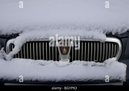 A Rover car in the snow, front view - Stock Photo