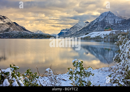 Prince of Wales Hotel overlooking Middle Waterton Lake after the first snowfall of winter, Waterton Lakes National - Stock Photo