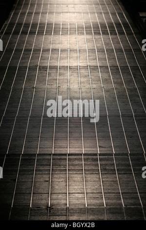 An industrial metal grid walkway background - Stock Photo
