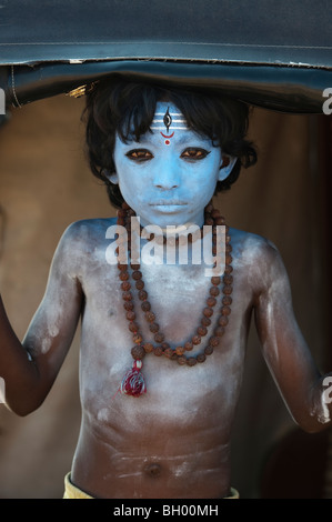 Indian boy, face painted as the Hindu god Shiva standing in a rickshaw. Andhra Pradesh, India - Stock Photo