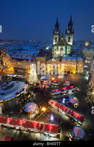 Overview from the Clock Tower of Christmas Market in the Old Town Square with the Church of Our Lady before Tyn - Stock Photo