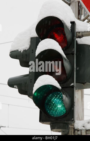 snow-covered traffic lights - Stock Photo