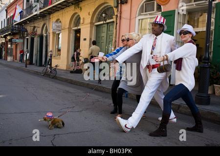 A street performer mime entertains tourists on Bourbon Street, French Quarter, New Orleans, Louisiana - Stock Photo