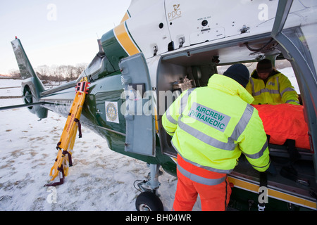The North West Air Ambulance scrambled to evacuate an injured walker in Langdale, Lake District, UK. - Stock Photo