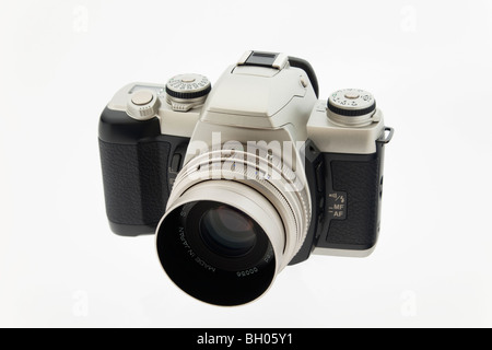 Studio still life. Retro style black and silver 35mm film camera and lens on white background - Stock Photo