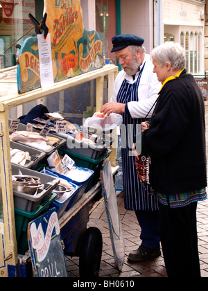 Dan the Fish Man, Selling some fish to a customer. - Stock Photo